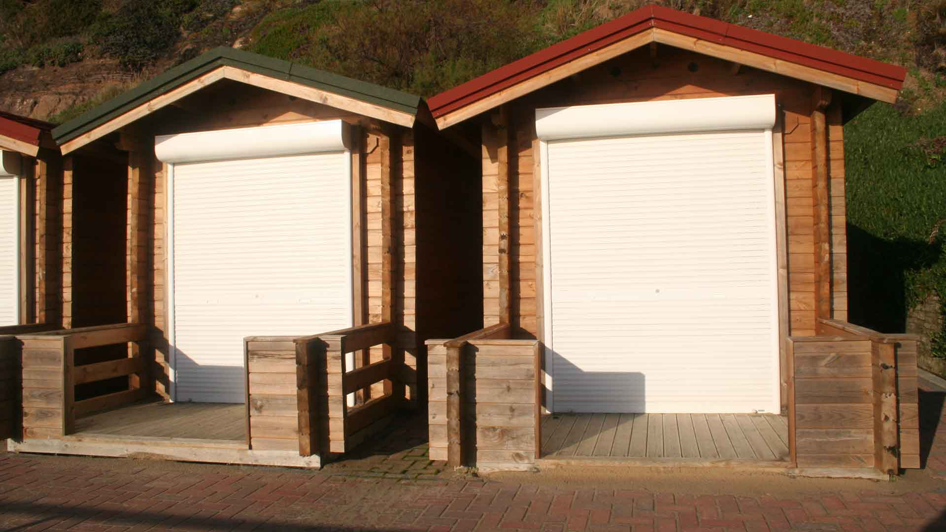 <b>fishermans-walk-gallery2.jpg</b> <br/> Different style of Huts at Fisherman's Walk Beach with roll up shutter.
